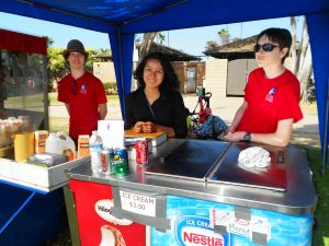 La Jolla High Key Club (part of Kiwanis) President Kiara Sanchez (center), Kellen & Kyle volunteer selling popcorn & ice cream
